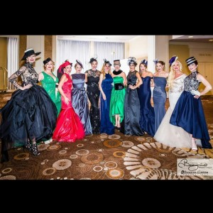 Certainly are a lot of housewives in this lineup shot by Thomas Garza at the Binzario Couture fashion show, but LeeAnne isn't one of them. There seems to be a token non married cast member on RH franchises though....